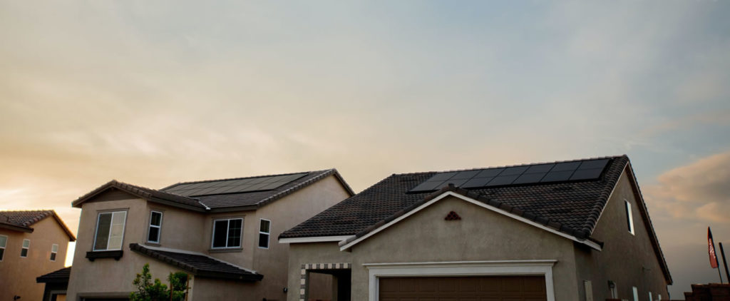 All-Black Solar Panels Mounted On Tile Roofs